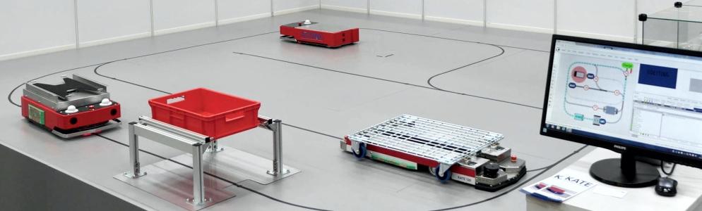 Foto: KATE Klein-FTF auf Fahrkusr mit TransportControl Leitsteuerung