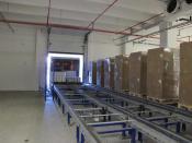Automatischer Lasttransfer mittels Stetigfördertechnik